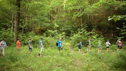 Members of the Breathitt County Hiking Club head back to their cars after ending the hike.
