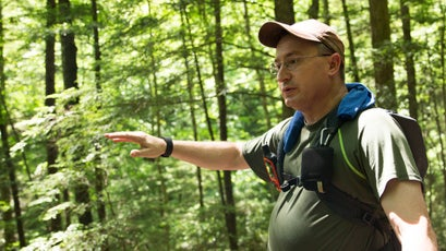 Stephen Bowling, head of the Breathitt County Hiking Club, addresses his group at their first water break, telling them about some of the area's history.