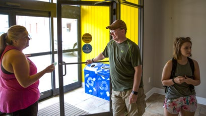 Stephen Bowling, head of the Breathitt County Hiking Club, chats with members as they prepare to caravan from their local library to the Red River Gorge.