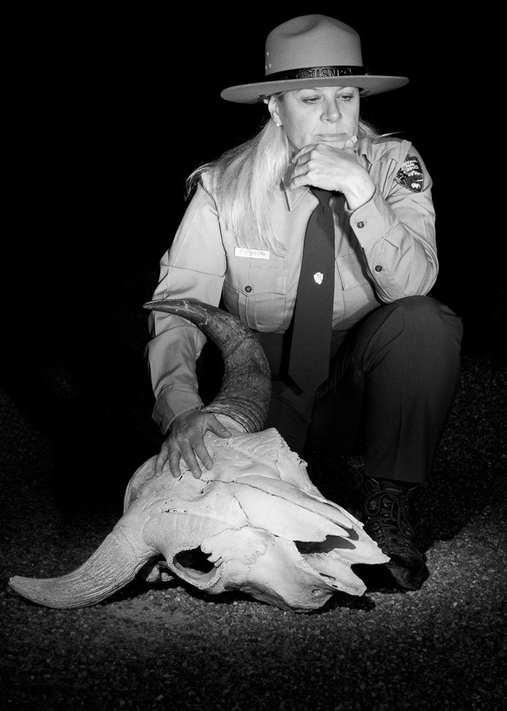 Beth contemplates the bison skull, which is used in ranger presentations and was moved for this portrait to Fountain Flats, Yellowstone National Park.