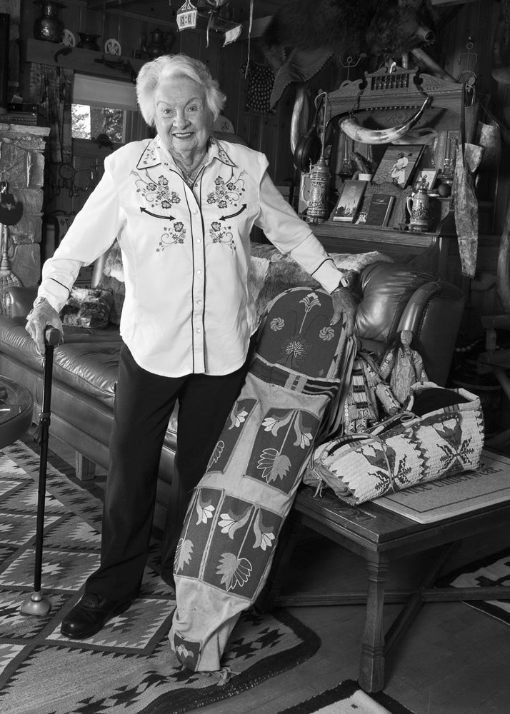 Ellie stands among artifacts collected by her family over 88 years during the Hamilton Stores era in Yellowstone National Park.