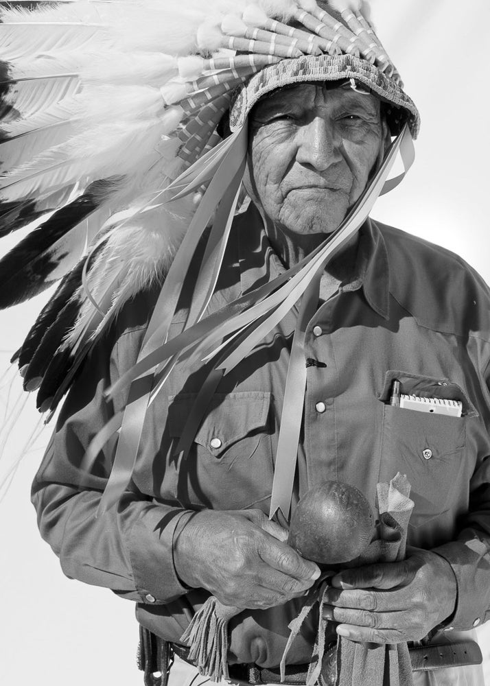 Grant wearing the headdress of the Crow Nation.
