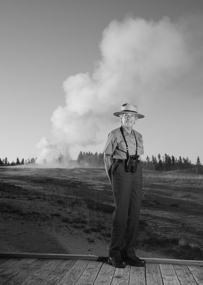 Katy stands in front of Old Faithful in Yellowstone, where she served as park ranger from 2002 to 2011.