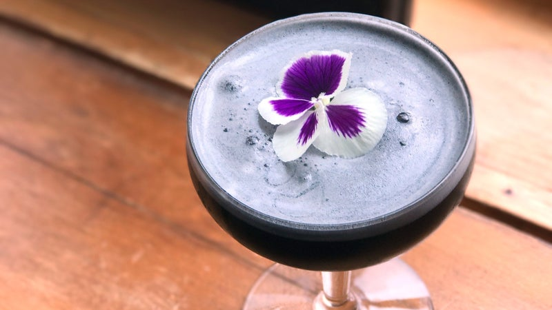 At Whiteface Lodge, mixologist Zachary Blair created a mezcal cocktail with activated charcoal.