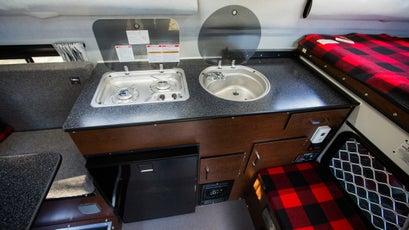 A full sink and stove, paired with an ice-cold refigerator pushes the camper into RV territory.