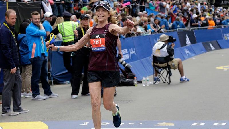 Kathrine Switzer crosses the finish line in the Boston Marathon, Monday, April 17, 2017.