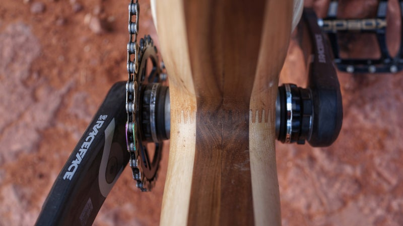 Layers of different woods bonded together determine the properties of individual frame components.