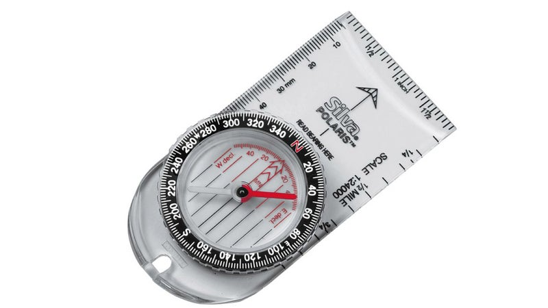 Any compass you want to use for navigation should look like this one. The prominent black arrow on the front is the direction of travel arrow. Inside the bezel, you can see the declination adjustments and the orienting lines. It also includes a scale for standard 1:24,000 topo maps, just to make estimating distances that much easier.