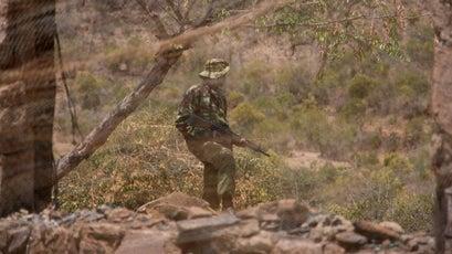 A KDF soldier patrols the site of Tristan Voorspuy's murder.