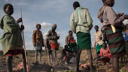 Pokot pastoralist youths barbecue dinner on the Mugie conservancy.