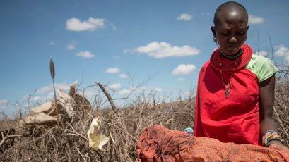 Lenjodor Cecilia holds rags used to stop bleeding after KDF soliders terrorized a small collection of Samaburu huts.