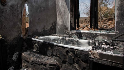 A burned tourist home on Tristan Voorspuy's conservancy.