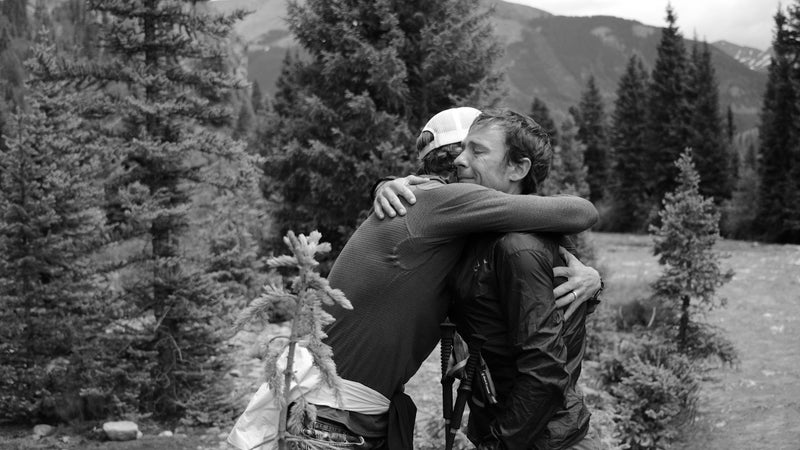 Adam receives a hug of encouragement from his coach Jason Koop on the Hardrock course.