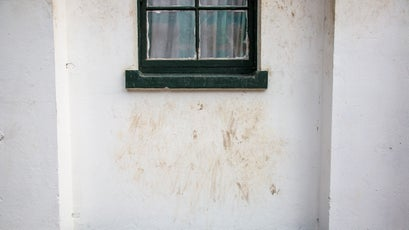 Markings left under a window where baboons have climbed to the roof.