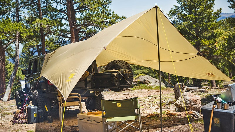 Slumberjack's new Roadhouse Tarp promises to outdo vehicle mounted awnings, both in space covered and ease of carry. Initial impressions of the one that just arrived in our office are good; we plan to give it a full test during our eclipse campout.