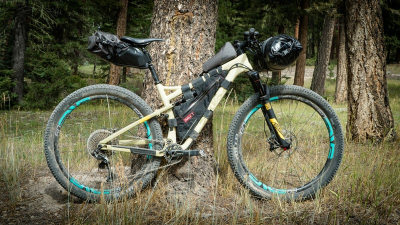 Salsa's Anything Cradle Plus Dry Bag, Seatpack, Top Tube Bag, and Spearfish Frame Bag.