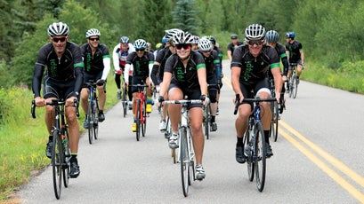 Armstrong rides with his daughter, Grace Armstrong during the Wapiyapi fundraising ride in Aspen, Colorado.
