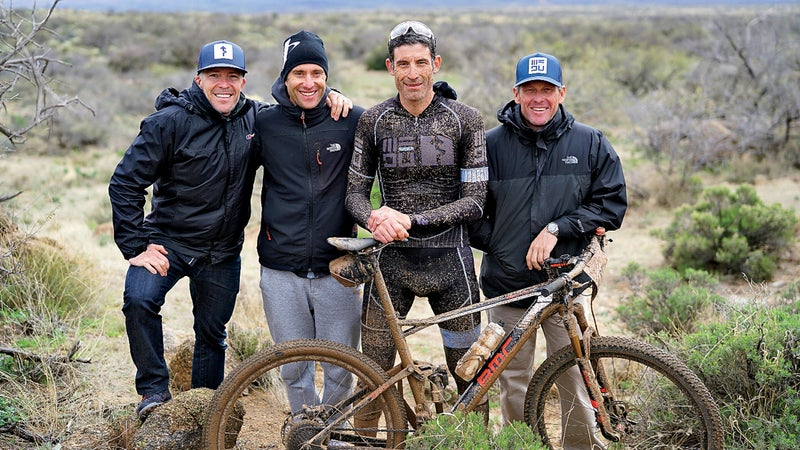 (L to R) Dylan Casey, Christian Vandevelde, George Hincapie and Armstrong pose for a WEDU team photo after finishing 3rd in the 24 Hours in the Old Pueblo 24 hour mountain bike race in Tucson, Arizona February 19, 2017. Casey, Vandevelde, Hincapie and Armstrong have been friends since they were teammates on US Postal cycling team.