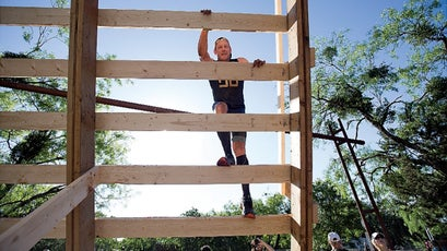 Armstrong climbs an obstacle during the Spartan Race in Austin, Texas.