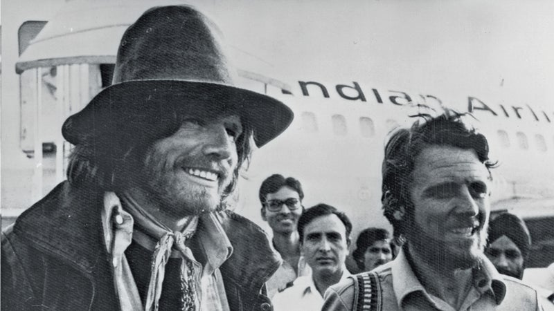 Reinhold Messner, 33, left and Peter Habeler, 35, on their way back to Europe after climbing Mount Everest without oxygen.