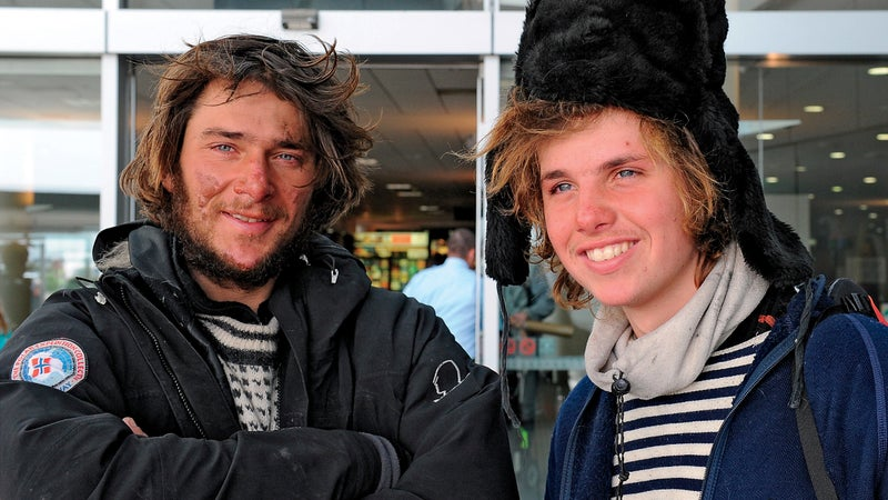 Norwegian adventurers Jarle Andhoy (L), age 34, and Samuel Massie (R), age 18,  arrive from Antarctica at Christchurch International Airport on February 28, 2011.