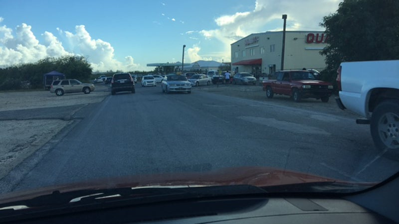 A grocery store in Turks and Caicos is a scene of frantic chaos.