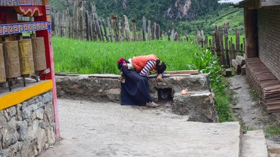 A local villager circumambulates Zhagana's local monastery, praying as she goes, a daily ritual for many Tibetans.