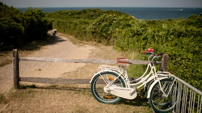 A trail near the site of the Montauk Point lighthouse in Montauk, N.Y., July 24, 2012. The site is one of many locations that offers roads less traveled to different Hamptons, far from the manicured landscapes, mansions and beach crowds. (/The New York Times)