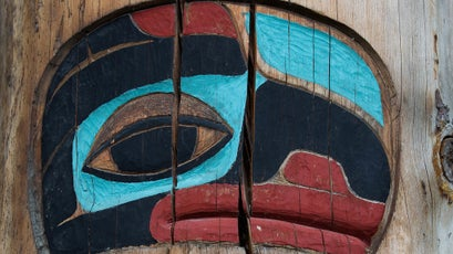 Traditional Chilkat artwork carved into the post of a communal building in Klukwan.