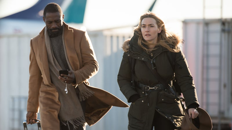 Kate Winslet and Idris Elba star in The Mountain Between Us as Dr. Ben Bass and Alex Martin, who survive a plane crash.