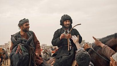 A Tajik general hands out money during a match in Mazar-e-Sharif.