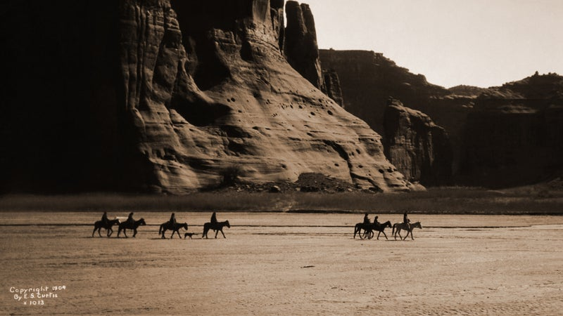 Riders in another Southwestern national monument, Canyon de Chelly.