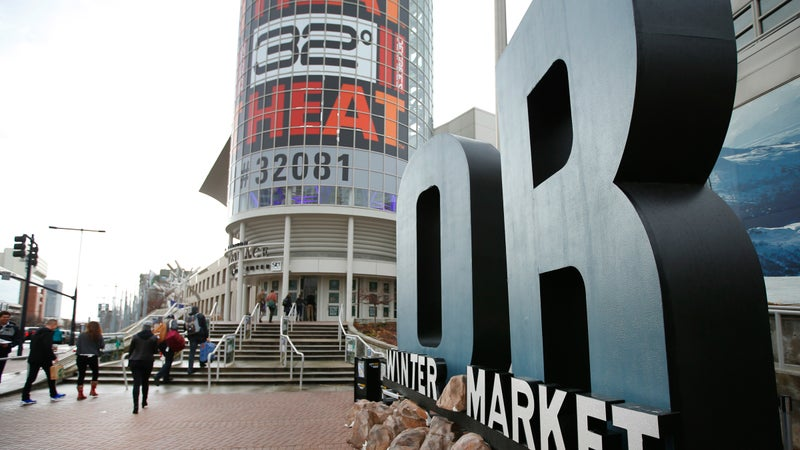 Attendees walk into the Salt Place Convention Center for the 2017 Outdoor Retailer Winter Market, January, 2017. (George Frey/Getty)