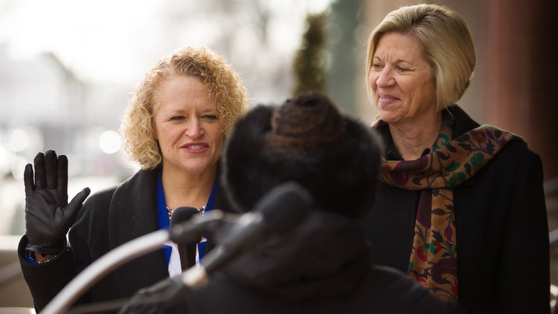 Jackie Biskupski, left, is sworn in as Salt Lake City's first openly gay mayor next to her fiancée, Betty Iverson, during a ceremony on Jan. 4, 2016, in Salt Lake City.