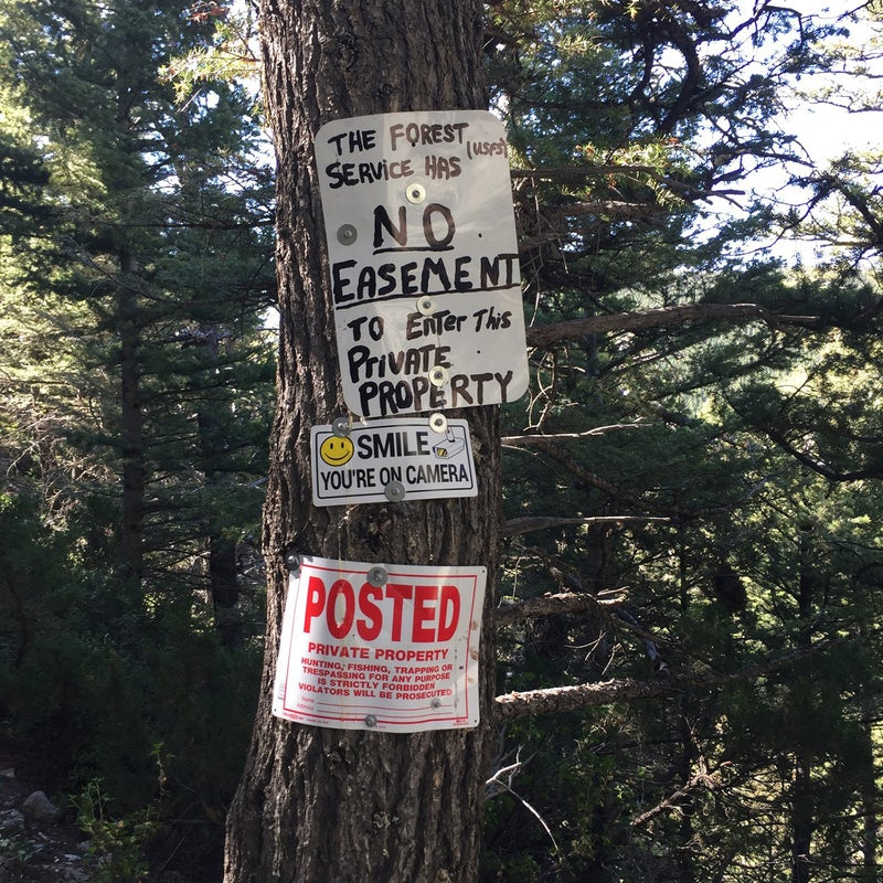 Signs posted by landowners where disputed Trail 136 crosses a private ranch in the east Crazies on its way to public lands. Advocates say the trail appears on forest maps at least as far back as the 1930s.