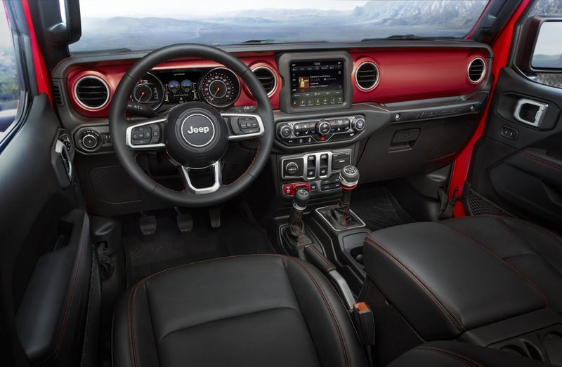 The new interior is modern and refined, with an available leather-wrapped dash and 8-inch infotainment screen. The red dash panels are made from aluminum and available in other colors if they're too loud for you and are replaceable.