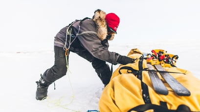 In rough ice, teams of two push, pull, and drag the pulks through.