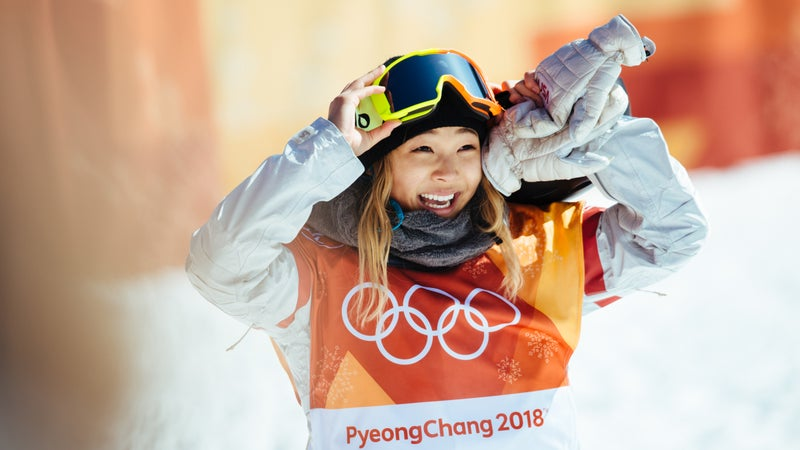 Chloe Kim reacts to her first run score of 93.75—enough to secure gold. Kim's victory lap, however, improved her score to a near-perfect 98.25.
