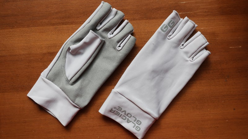 The Glacier Glove Ascension Bay Sun Gloves have a synthetic leather palm and polyester/Lycra top.