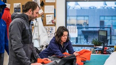 Arc'teryx design manager Greg Grenzke and apparel designer Brylee Geddis go over Alpha SV details at the Vancouver headquarters.