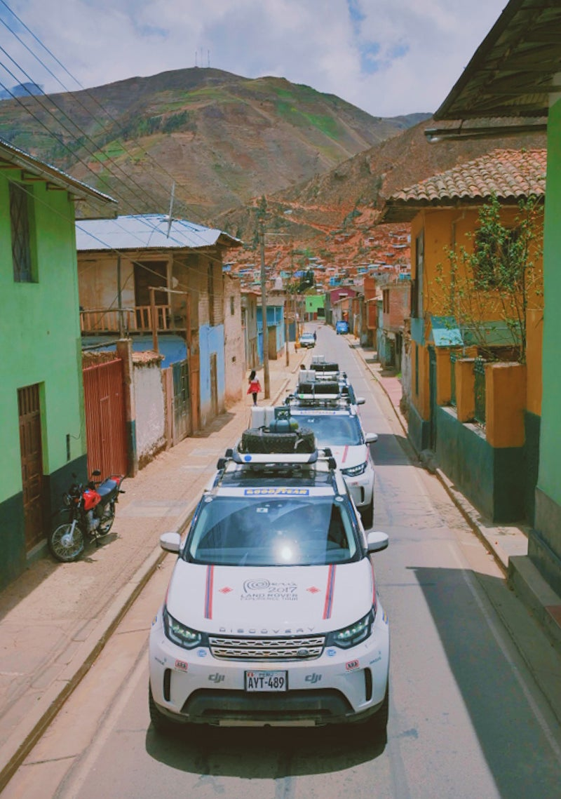Fourteen new Land Rovers driving through town is the closest thing this small Peruvian village will ever experience to rush hour.