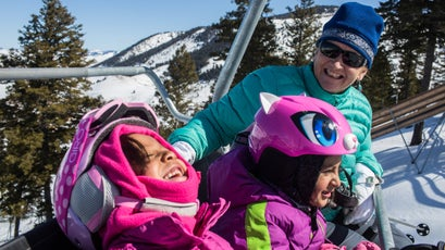 Coombs jokes with young foundation skiers recently while riding the chairlift at Snow King Mountain. Foundation participants ski every Saturday through the winter at Snow King with the help of instructors.