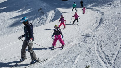 Snow King ski instructor Ramona Davis works on turns with a young group of Coombs Foundation skiers.
