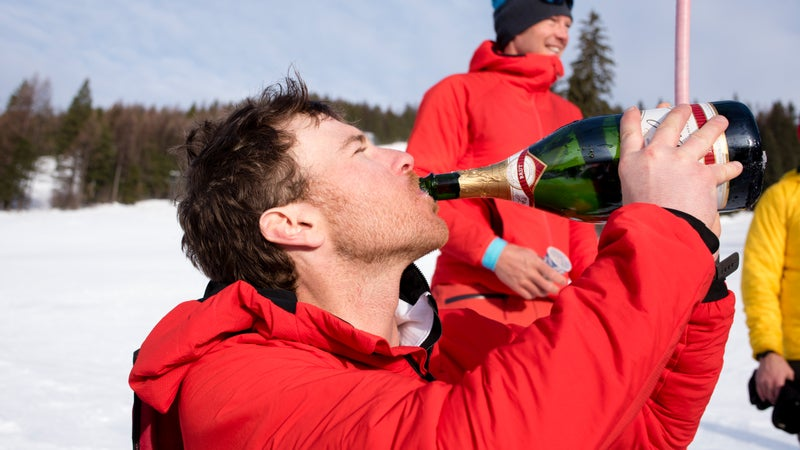 Foote takes a swig of champagne after breaking the world record.