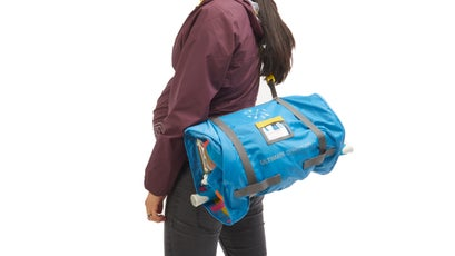 When not hung from the back of a seat, the bag rolls up and is easily carried.