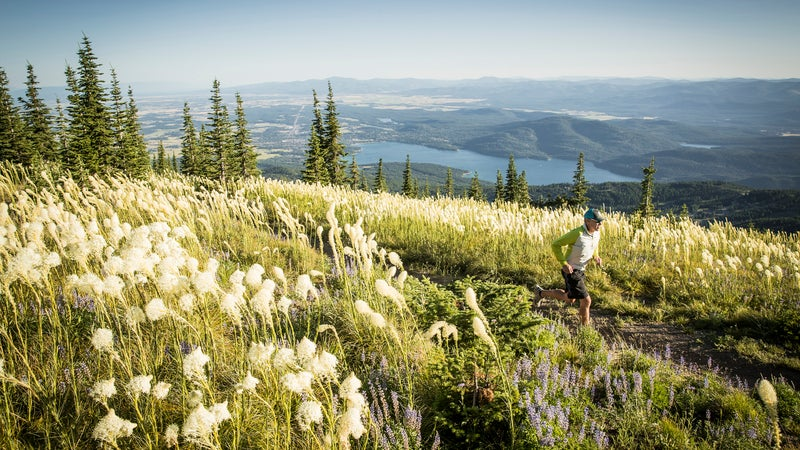 Trail running above the seven-mile glacial Whitefish Lake.