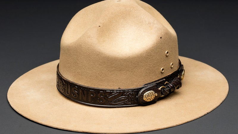 """Here's the hat in it's correct orientation. You'd think the USNPS embossing would be hard to miss, and hard to get backwards, right? """"The hatband is to be worn with the USNPS logo centered in the front,"""" read the Park Service's uniform regs. The brass buttons should be over the wearer's left shoulder."""