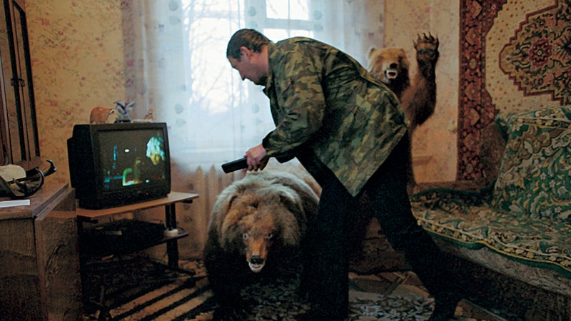 """""""Sometimes it gets lonely, just the three of us"""": Pavel, a Russian hunter, in his apartment outside Petropavlovsk-Kamchatsky"""