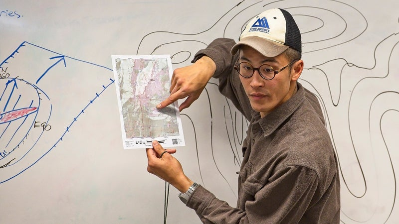 Don Nguyen demonstrates navigation with topo maps and compass at the Climbers of Color mountaineering workshop in Seattle, April 28.
