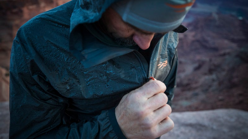 The jacket's feature set includes everything you need—robust, full-length zipper, zippered hand packets, hood adjustment—and nothing you don't.